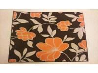 Friese brown and orange floral rug 96cm x 136cm