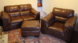 For Sale Real Leather Two Seater Sofa, matching Armchair and storage footstool .