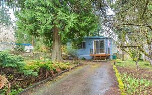 Mobile Home with Development Potential!