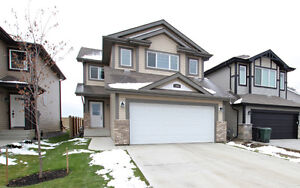 PERFECT FOR THE FAMILY IN SPRUCE GROVE! BACKS ON TO POND AREA!