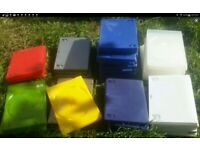 A selection of coloured empty dvd or cd cases in white, red, green colours. Good condition