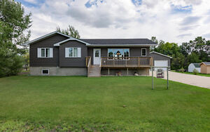 Beautiful Family Home Located in Woodlands, MB