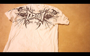 Tap Out Shirt for SALE, has a yellow stain on it small