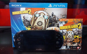 PS Vita Slim complete game kit with large amount of accessories.