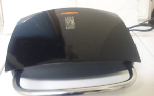 GEORGE FOREMAN LEAN MEAN GRILLING MACHINE! AS NEW $25!
