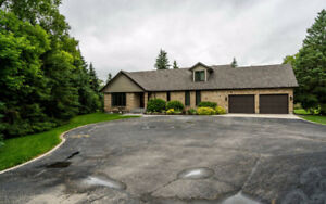 ** STUNNING Executive style home in St.Andrews on 1.4 Acres **