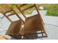 4 wooden chairs in need of tlc