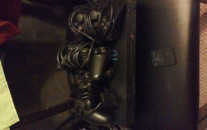 Playstation2 console with 3 controllers and 8gb memory pack $50