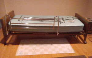 Electric hospital bed with side rails.