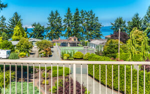 For rent - Top 2 floors of furnished ocean view home in Qualicum