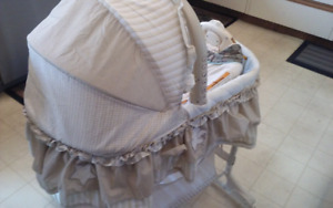 AS NEW CONDITION BASSINET MUSICAL ON STAND WITH SKIRT