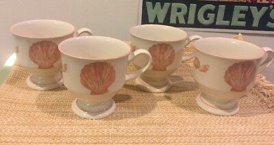 Four Sango Coquille Footed Mugs