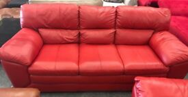 DFS red leather 3 seater sofa and Footstool