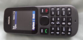Mobile phone Nokia complete with charger, with £6 of credit on Tesco PAYG network. Excellent
