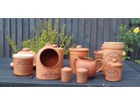 Thirteen pieces of terracotta kitchen storage jars etc.