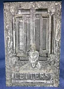 Vintage cast metal letter slot with knocker