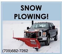 Snow clearing driveway plowing call or text 1-709-682-7262