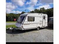 2 berth caravan with full awning and accessories. Free delivery available.