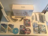 Wii complete impeccable -manette -nunchock -jeux - 80$