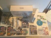 Wii complete impeccable -manette -nunchock -jeux - 90$