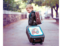 Kids luggage SIMILAR to the one on the photograph. No real photo and cannot provide the one.