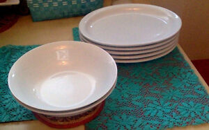 White china bowls and large platters and bowls