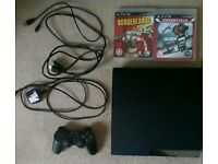 Sony PlayStation 3 with one controller and two games