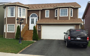 STUNNING RAISED BUNGALOW IN AIRPORT HEIGHTS WITH BUILT-IN GARAGE