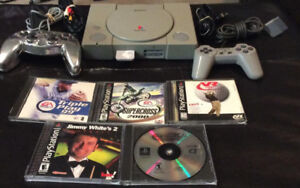 Playstation 1 With 2 Controllers/MemoryCard and 5 Games