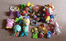 Various baby buggy pram rattle sensory toys. Lamaze nuby mothercare