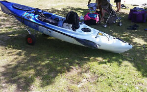 New barely used sit in fishing Kayak w Premium seat and a Dolly!