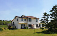 Want to live on Lawrencetown beach?...here we go!  Duplex.