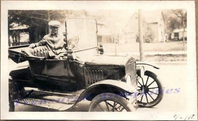 Young Man Driving Classic 1917 Ford Model T Open Roadster Car Automobile Photo