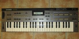Casio CZ-101 1980's Electronic Keyboard Synthesizer with original adapter and manuals