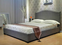 Upholstered fabric bed with studs