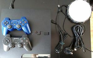 PS3 Console + 2 controllers (+ Skylanders base & various games)