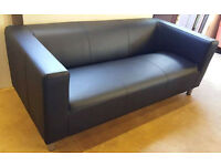 Brand New Moda Leather Effect Sofa - Jet Black. Can deliver