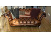 Brown leather 3 seater and wing chair.