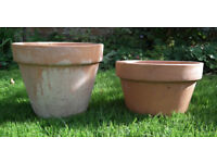 """Two clay terracotta flower pots, medium size, in good used condition, both around 10"""" diameter."""