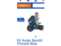 Toddlers ride on electric bike
