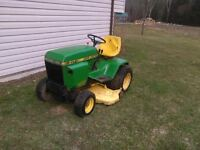 John Deere 317 with mower
