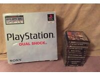 Boxed Playstation 1 mint with 12 games including resident evil 2
