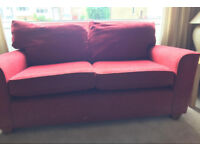 2 red2 seated sofas