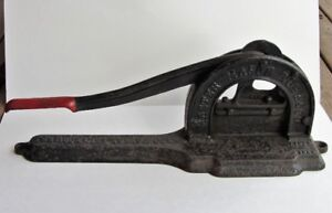 TWO FABULOUS ADVERTISING CAST IRON TOBACCO CUTTERS