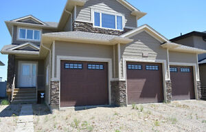 495 Mahabir, 2024' w Triple Garage, Well located in Evergreen!