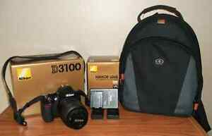 Nikon D3100 with 18-55mm Kit Lens, 2 Batteries, Bag and Flash