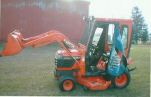Compact Kubota with loader, cab, and mower
