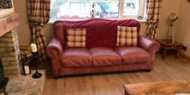 2 leather sofas and foot stool
