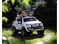 Licensed 12v Ford Ranger ride on car with remote control music and lights (leeds) only £230