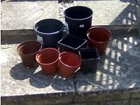 Bag of assorted plastic garden pots, used but in good condition.